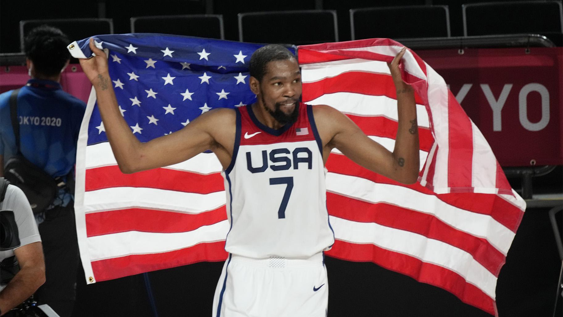 United States' Kevin Durant (7) celebrates after their win in the men's basketball gold medal game against France at the 2020 Summer Olympics, Saturday, Aug. 7, 2021, in Saitama, Japan. (AP Photo / Luca Bruno)