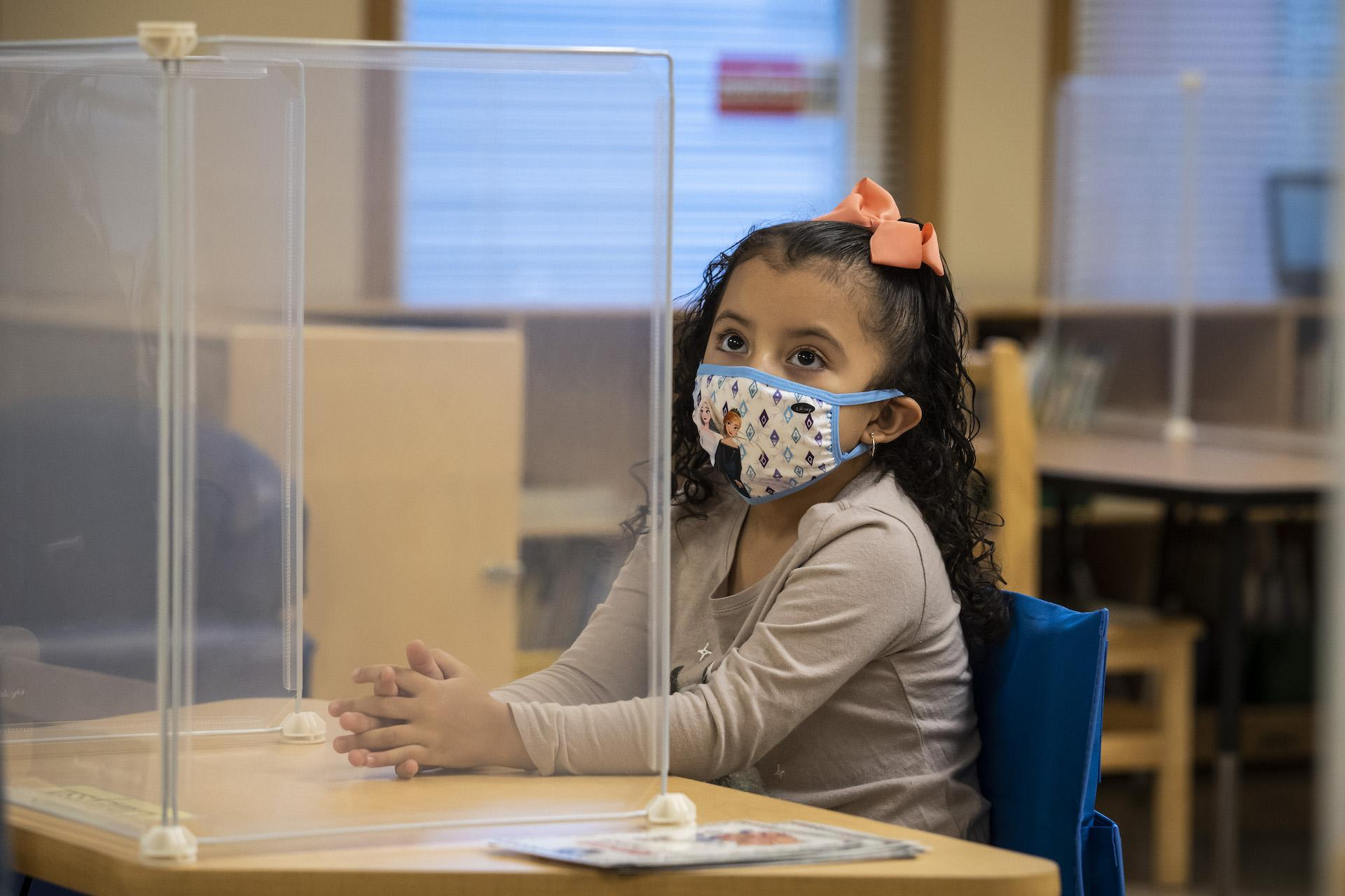 A preschool student listens as her teacher talks during class at Dawes Elementary School at 3810 W. 81st Place on the Southwest Side, Monday morning, Jan. 11, 2021. (Ashlee Rezin Garcia / Chicago Sun-Times / Pool)