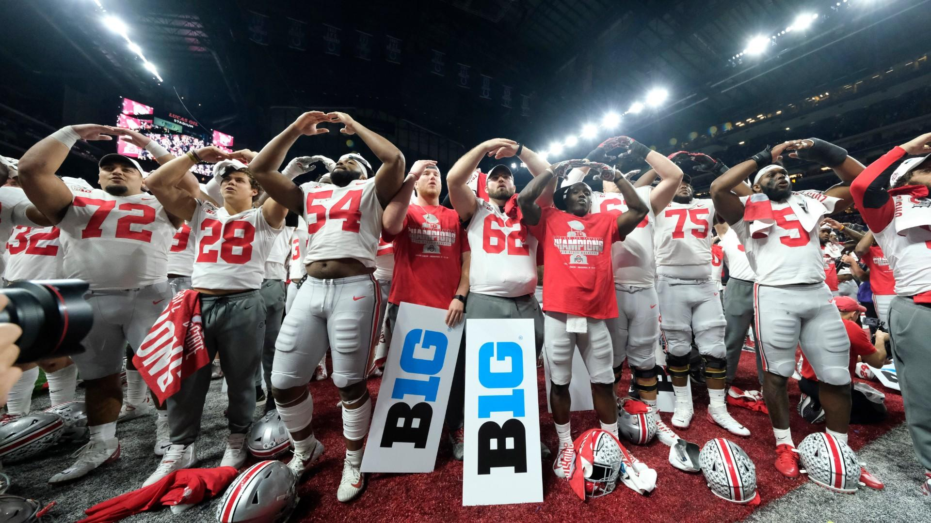 In this Dec. 8, 2019, file photo, Ohio State players celebrate the team's 34-21 win over Wisconsin in the Big Ten championship NCAA college football game, in Indianapolis. (AP Photo / AJ Mast, File)