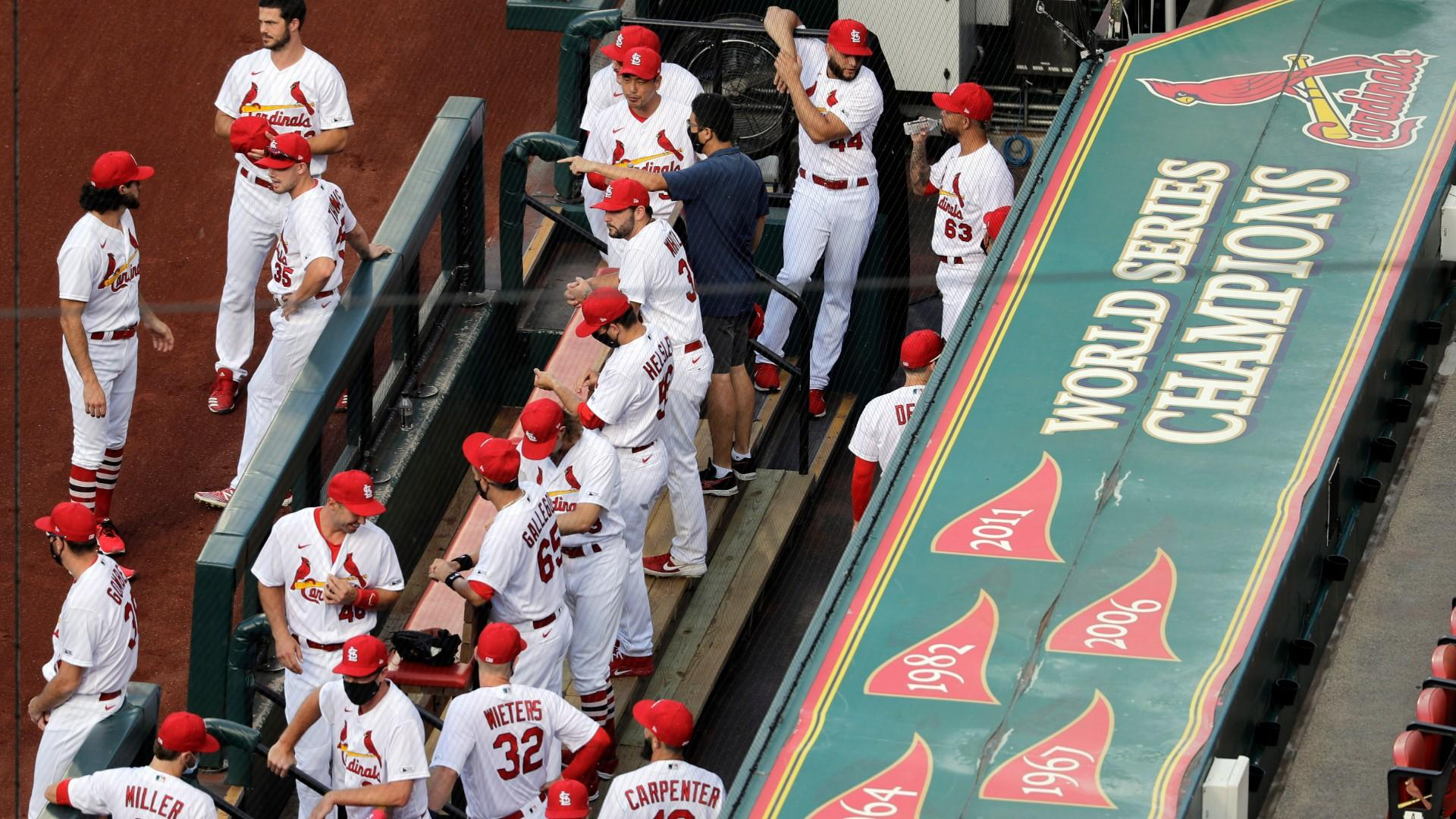 In this July 24, 2020, file photo, members of the St. Louis Cardinals wait to be introduced before the start of a baseball game against the Pittsburgh Pirates in St. Louis. (AP Photo / Jeff Roberson, File)