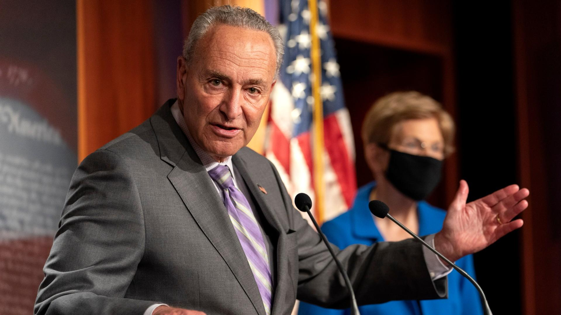 Senate Minority Leader Sen. Chuck Schumer of N.Y., left, with Sen. Elizabeth Warren, D-Mass., speaks during a news conference, Wednesday, Sept. 9, 2020, on Capitol Hill in Washington. (AP Photo / Jacquelyn Martin)