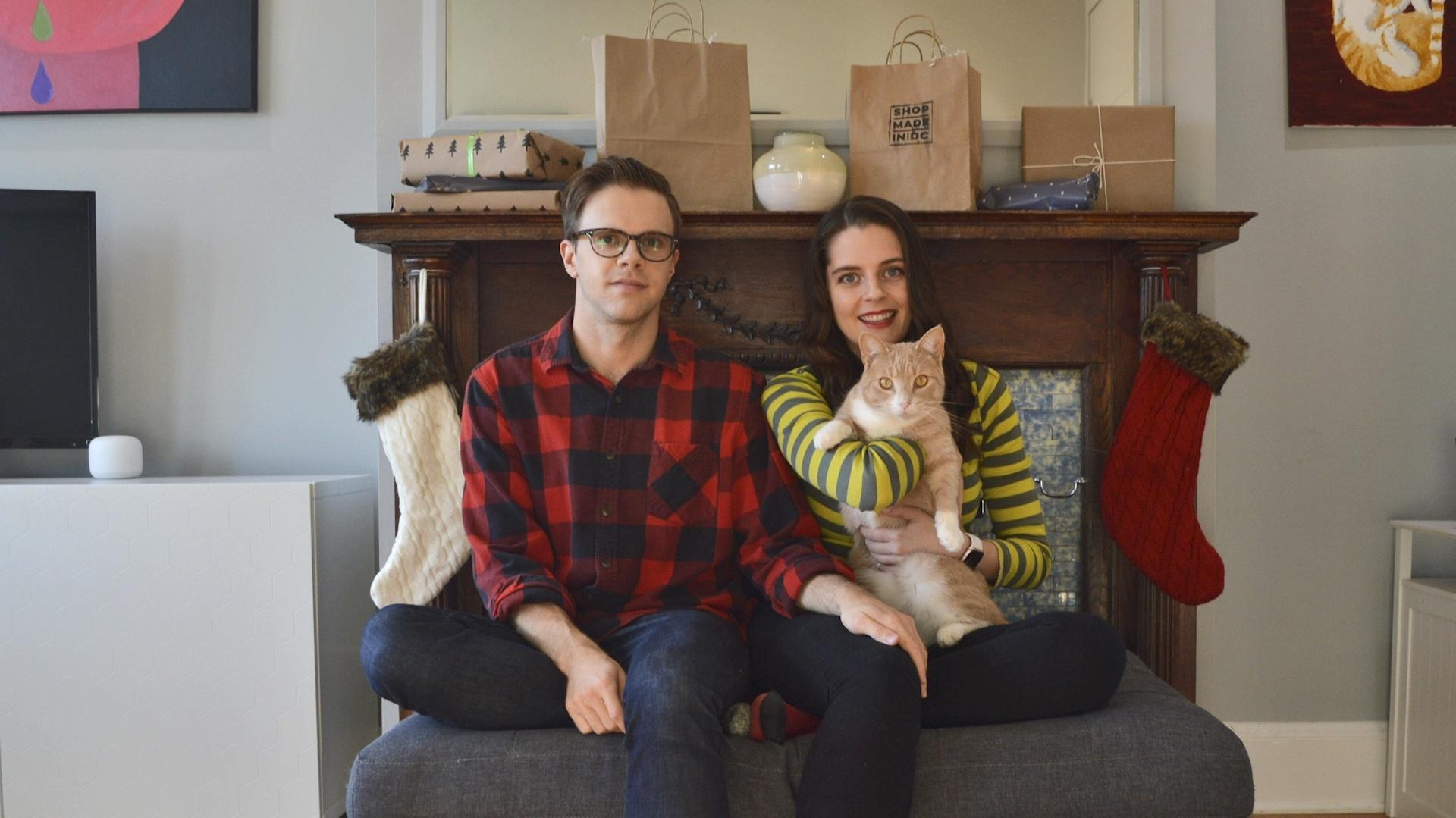 In this photo provided by Kate Hilts, Ross Hettervig, left, and Kate Hilts pose for a photo with their cat, Potato, on Nov. 14, 2020, in Washington. (Kate Hilts via AP)
