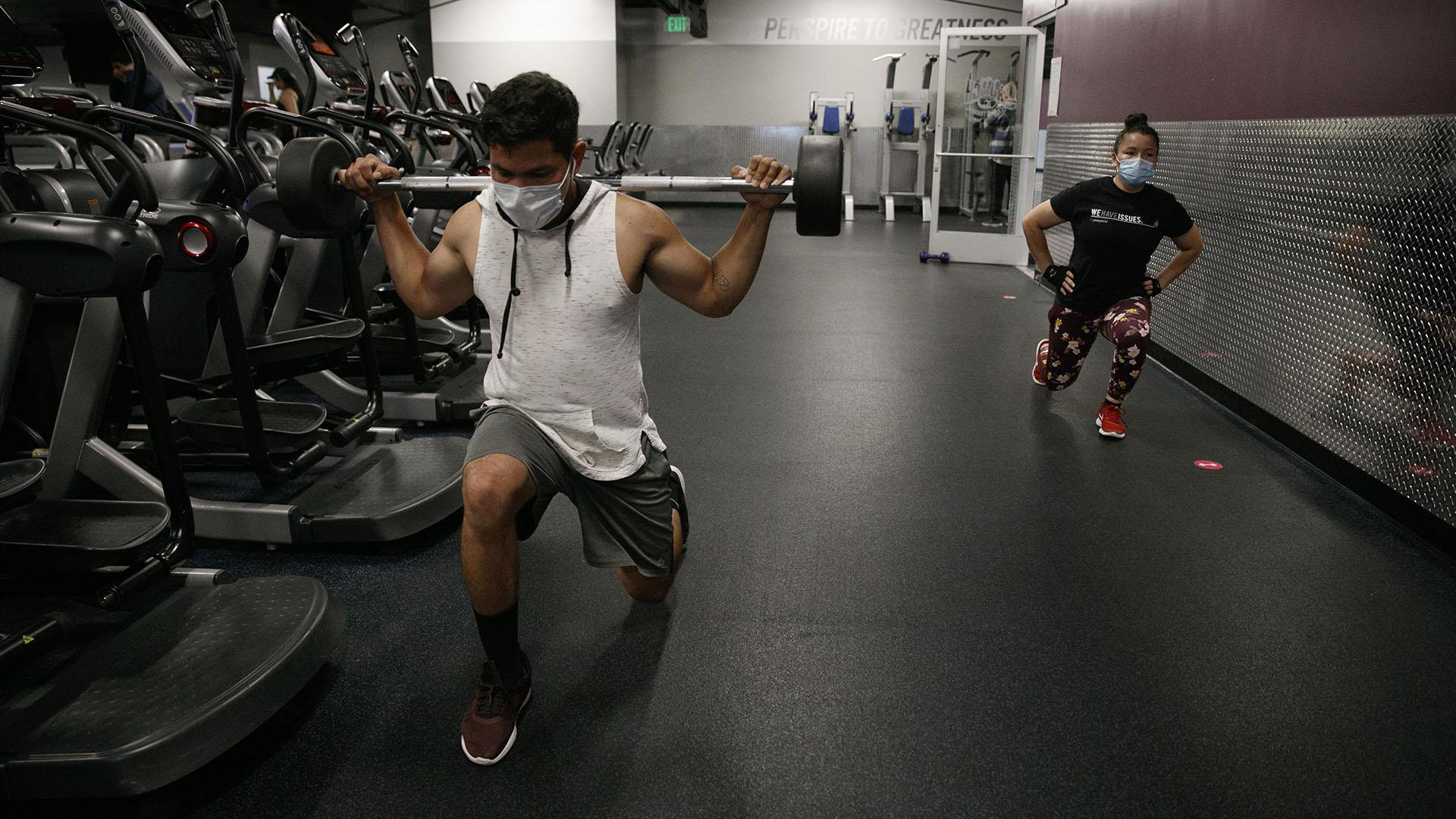 In this Friday, June 26, 2020 file photo, people wear masks while exercising at a gym in Los Angeles. (AP Photo / Jae C. Hong)