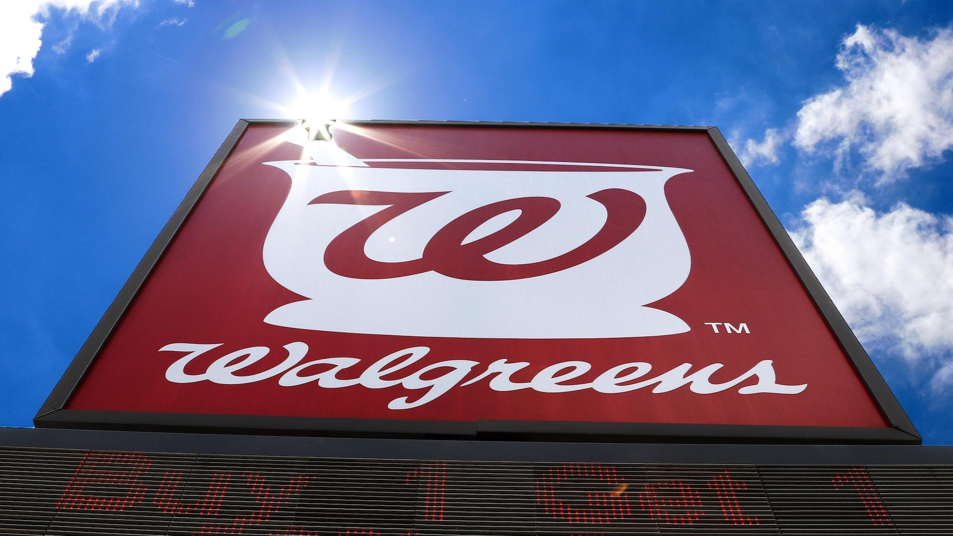 This June 25, 2019, file photo shows the sign outside a Walgreens Pharmacy in Pittsburgh. Walgreens Boots Alliance will sell its pharmaceutical wholesaler business to AmerisourceBergen in $6.5 billion cash and stock deal. (AP Photo/Gene J. Puskar, File)