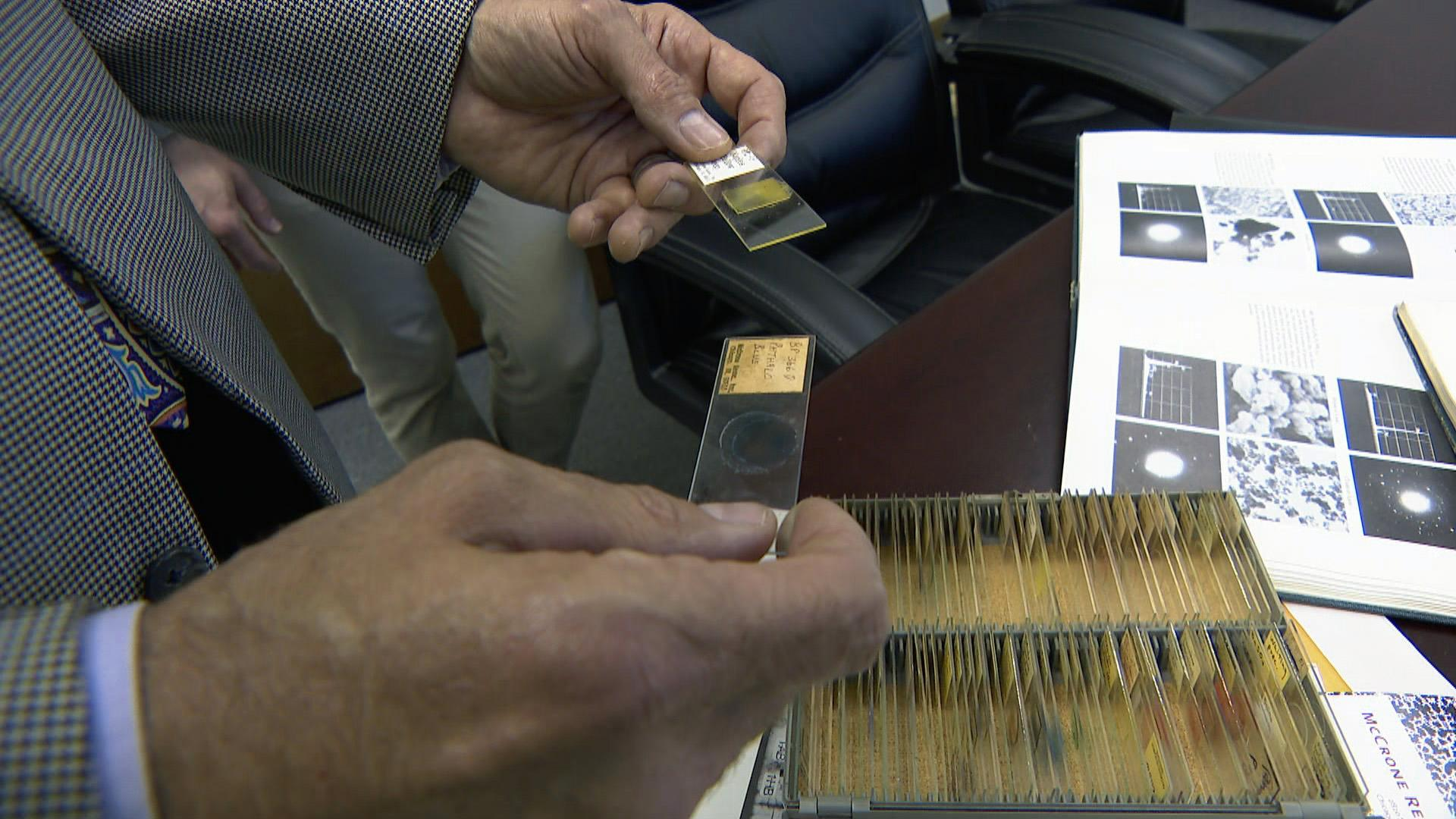 Gary Laughlin handles specimens at the McCrone Research Institute in Bronzeville, founded in 1960 by Walter McCrone.  (WTTW News)