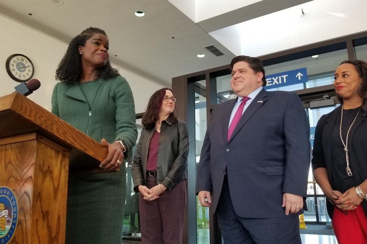 Cook County State's Attorney Kim Foxx, left, stands beside Gov. J.B. Pritzker inside the lobby of the Leighton Criminal Court Building on Wednesday, Dec. 11, 2019. (Matt Masterson / WTTW News)