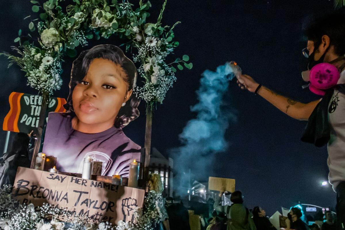 Protesters march against police brutality in Los Angeles, on Sept. 23, 2020, following a decision on the Breonna Taylor case in Louisville, Kentucky. (Apu Gomes / AFP / Getty Images)
