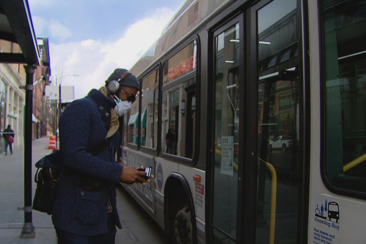 A passenger wearing a face mask boards a CTA bus in Chicago. (WTTW News)