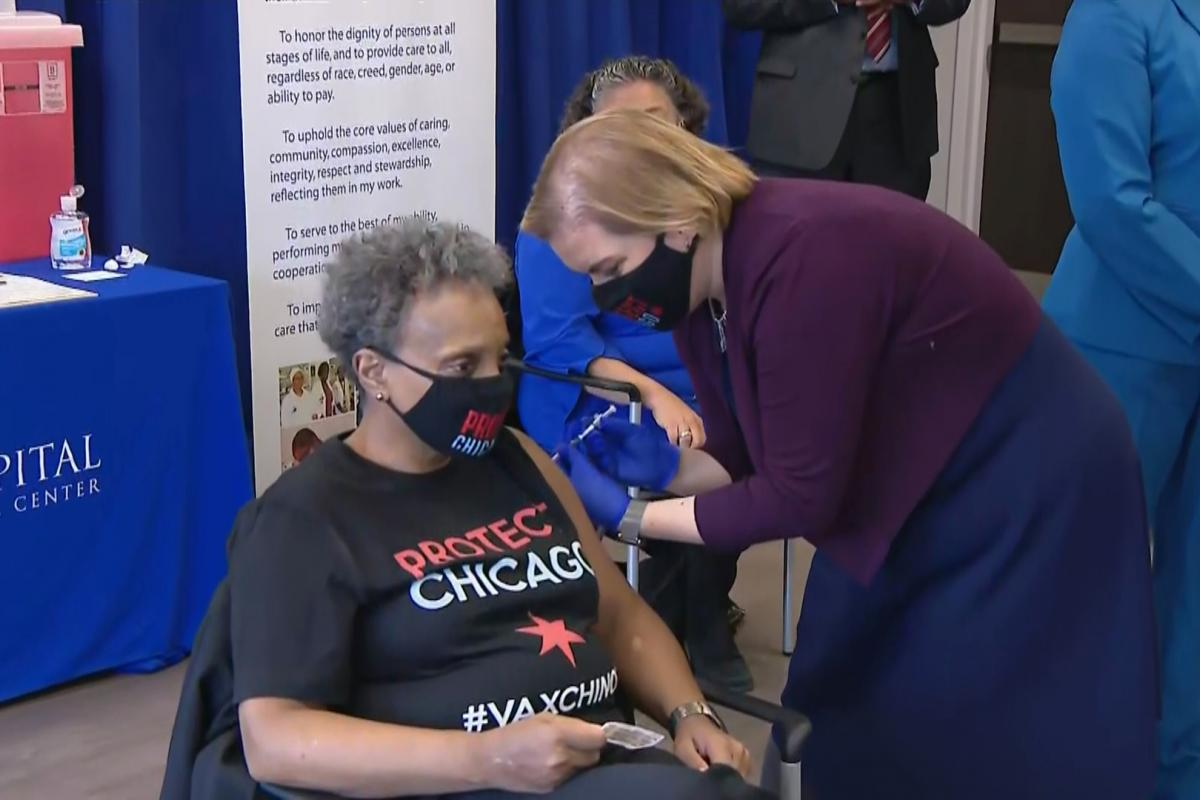 Mayor Lori Lightfoot gets her first COVID-19 vaccine shot, administered by Chicago Department of Public Health Commissioner Dr. Allison Arwady, at St. Bernard's Hospital in Englewood on Monday, Jan. 25, 2021. (WTTW News)