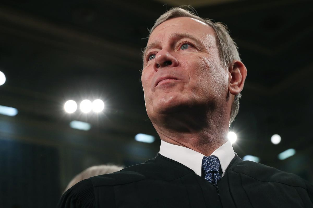 In this Tuesday, Feb. 4, 2020, file photo, Supreme Court Chief Justice John Roberts arrives before President Donald Trump delivers his State of the Union address to a joint session of Congress on Capitol Hill in Washington. (Leah Millis / Pool via AP, File)