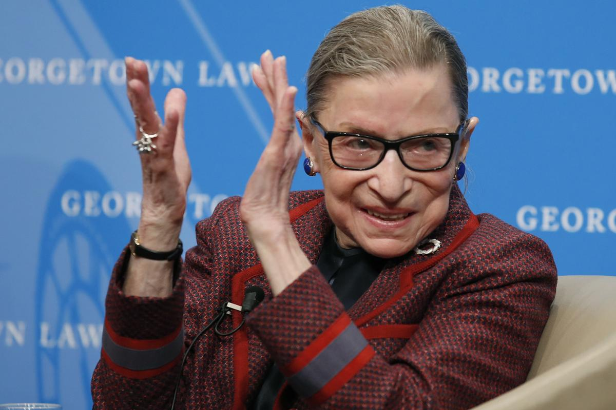 In this April 6, 2018, file photo, Supreme Court Justice Ruth Bader Ginsburg applauds after a performance in her honor after she spoke about her life and work during a discussion at Georgetown Law School in Washington. (AP Photo / Alex Brandon, File)
