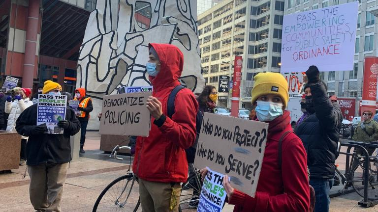 Supporters of the Empowering Communities for Public Safety plan call for more police accountability during a rally April 21, 2021. (Heather Cherone / WTTW News)