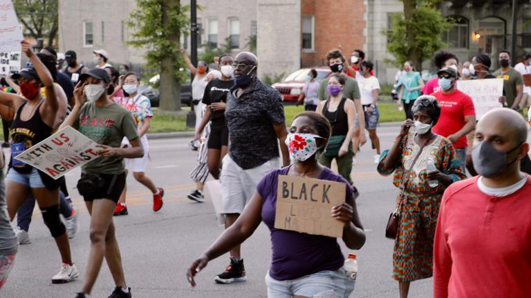 Protesters march along Martin Luther King Jr. Drive in Bronzeville on Tuesday, June 2, 2020, just over a week after the death of George Floyd at the hands of Minneapolis police. The peaceful demonstration was organized by local faith leaders. (Evan Garcia / WTTW News)