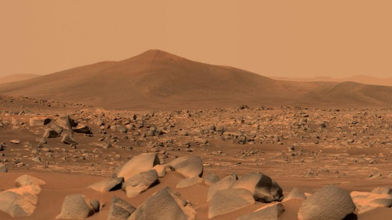 "NASA's Perseverance Mars rover used its dual-camera Mastcam-Z imager to capture this image of ""Santa Cruz,"" a hill about 1.5 miles away from the rover, on April 29, 2021, the 68th Martian day, or sol, of the mission. The entire scene is inside of Mars' Jezero Crater; the crater's rim can be seen on the horizon line beyond the hill. (Credit: NASA / JPL-Caltech / ASU / MSSS)"