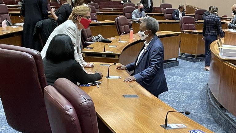 Mayor Lori Lightfoot speaks with Alds. Susan Sadlowski Garza (10th Ward) and Emma Mitts (37th Ward) before detailing her 2022 spending plan on Monday, Sept. 20, 2021. (Heather Cherone / WTTW News)