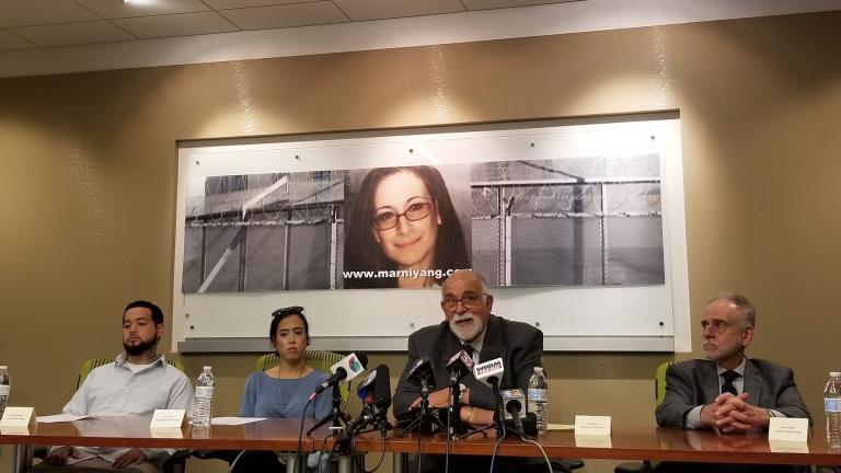 Attorney Jed Stone, center, speaks during a news conference Wednesday discussing his new petition for Marni Yang's freedom. He is surrounded by Yang's children, left, Andrew and Emily, and her father Larry Merar. (Matt Masterson / WTTW News)