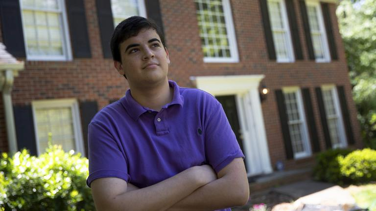 College student Jake Mershon poses in front of his parents home Thursday, May 7, 2020, in Roswell Ga. (AP Photo / John Bazemore)