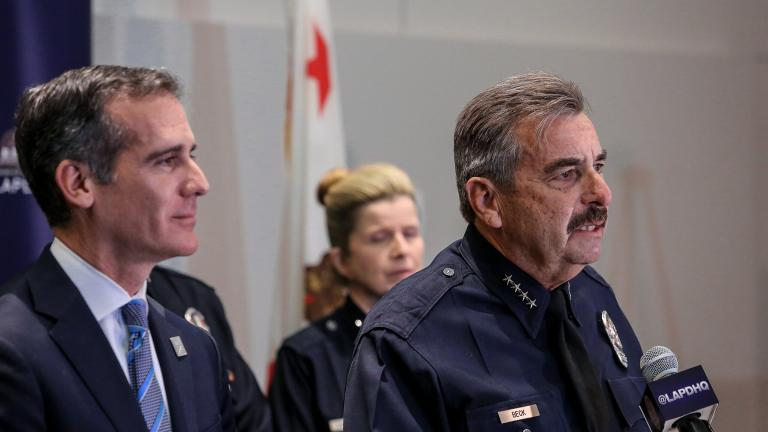 Charlie Beck, right, speaks during a press conference in 2018 while Los Angeles Mayor Eric Garcetti, left, looks on. On Friday, the former LAPD chief was named Chicago's interim police superintendent. (Eric Garcetti / Flickr)