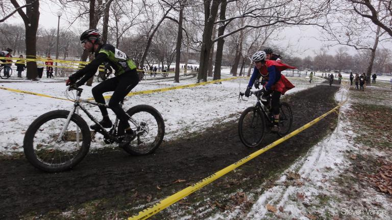 Cyclocross racers, including one in costume, take part in Afterglow 2011.