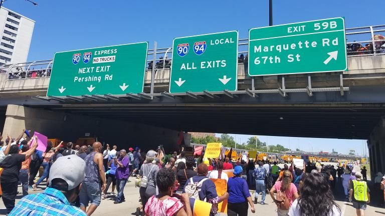 Protesters move into the home stretch Saturday under a 71st Street overpass filled with hundreds more onlookers. (Matt Masterson / Chicago Tonight)