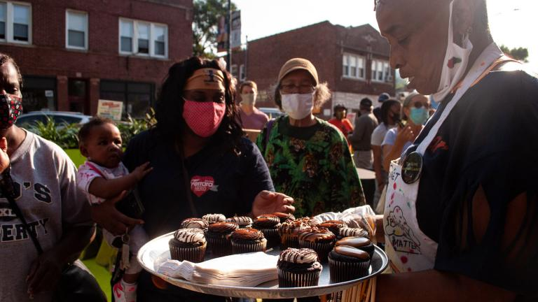 Brown Sugar Bakery employees hand out free cupcakes as part of the 75th Street Boardwalk grand opening on Saturday, Sept. 5, 2020. (Grace Del Vecchio / WTTW News)
