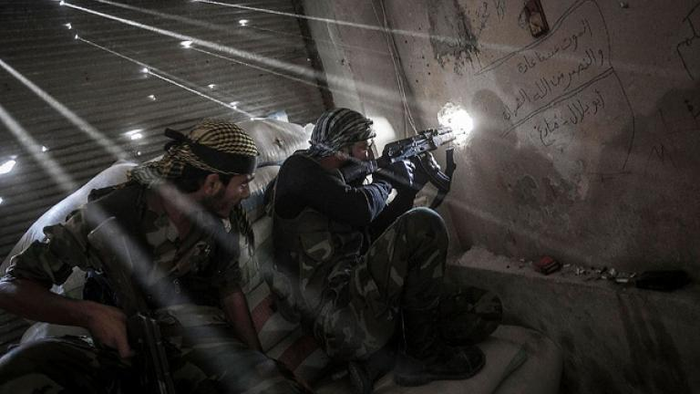 Rebel fighters watch over the enemy position during skirmishes last year in Aleppo, Syria. (Courtesy Creative Commons/Narciso Contreras)