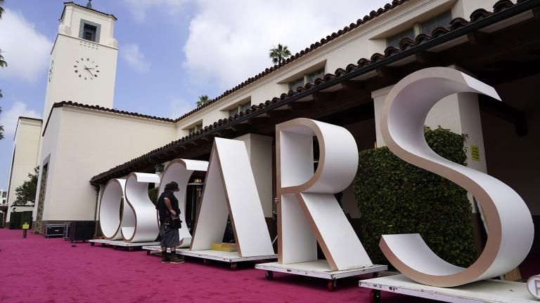 An Academy Awards crew member looks over a background element for the red carpet at Union Station, one of the locations for Sunday's 93rd Academy Awards, Saturday, April 24, 2021, in Los Angeles. (AP Photo / Chris Pizzello)