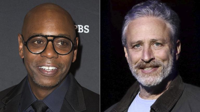 Comedian Dave Chappelle arrives at Kennedy Center for the Performing Arts to receive the 22nd Annual Mark Twain Prize for American Humor in Washington on Oct. 27, 2019, left, and comedian Jon Stewart performs at the 9th Annual Stand Up For Heroes event in New York on Nov. 10, 2015. (AP Photo)