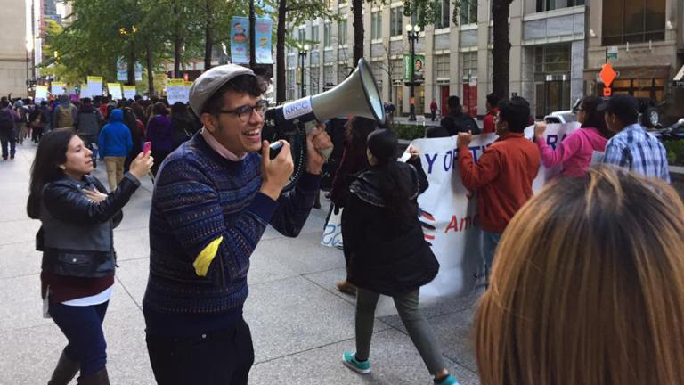 Mateo Uribe Rios leads student activists in a march from the Chicago Temple to the Thompson Center on Nov. 11. (Courtesy of Debbie Patiño)