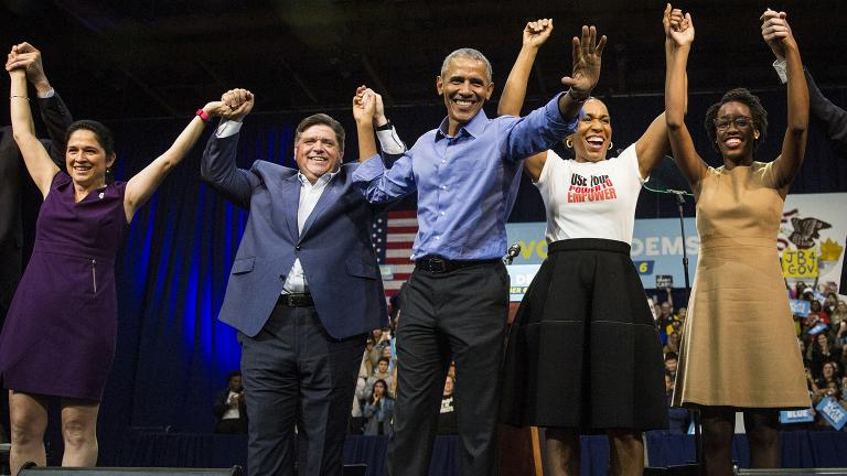 Former President Barack Obama, center, headlines a rally and appears alongside, from left to right, Illinois Comptroller Susana Mendoza, gubernatorial candidate J.B. Pritzker, lieutenant governor candidate Juliana Stratton and congressional candidate Lauren Underwood on Sunday, Nov. 4, 2018 at the University of Illinois at Chicago. (Ashlee Rezin / Chicago Sun-Times via AP)