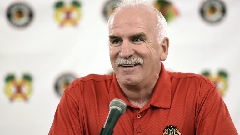 Chicago Blackhawks' head coach Joel Quenneville speaks at a news conference July 21, 2017, during the NHL hockey team's convention in Chicago. (G-Jun Yam / AP File Photo)