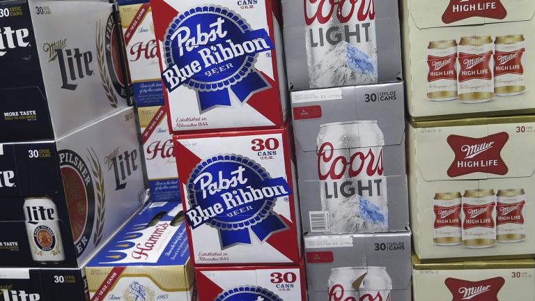 In this photo taken on Thursday, Nov. 8, 2018, cases of Pabst Blue Ribbon and Coors Light are stacked next to each other in a Milwaukee liquor store. (Ivan Moreno / AP Photo)
