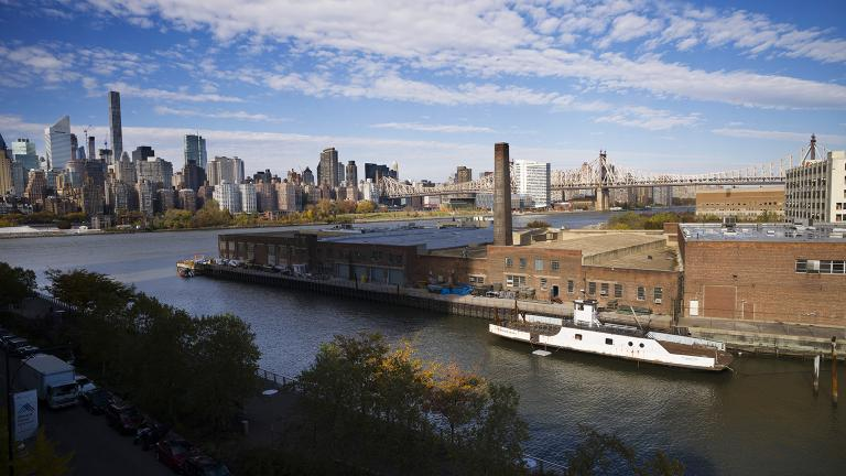 In this Wednesday, Nov. 7, 2018, photo, a rusting ferryboat is docked next to an aging industrial warehouse on Long Island City's Anable Basin in the Queens borough of New York. (Mark Lennihan /AP Photo)