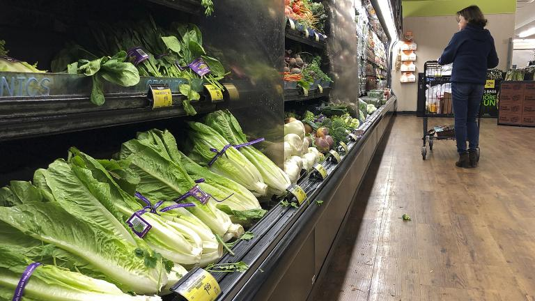 Romaine lettuce still sits on the shelves as a shopper walks through the produce area of an Albertsons market Tuesday, Nov. 20, 2018, in Simi Valley, Calif. (Mark J. Terrill / AP Photo)