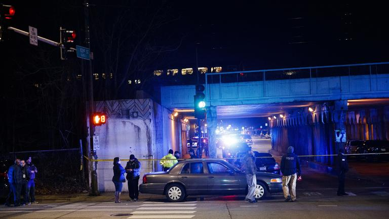 Police investigate the scene where two officers were killed after they were struck by a South Shore train near 103rd Street and Dauphin Avenue on Monday, Dec. 17, 2018. (Armando L. Sanchez / Chicago Tribune via AP)