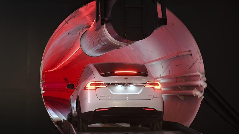 A modified Tesla Model X drives in the tunnel entrance before an unveiling event on Tuesday, Dec. 18, 2018 for the Boring Co. Hawthorne test tunnel in Hawthorne, Calif. (Robyn Beck / Pool Photo via AP)