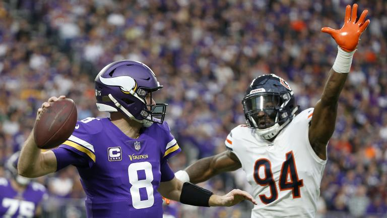 Minnesota Vikings quarterback Kirk Cousins (8) looks to throw a pass over Chicago Bears outside linebacker Leonard Floyd (94) during the first half of an NFL football game, Sunday, Dec. 30, 2018. (Bruce Kluckhohn / AP Photo)