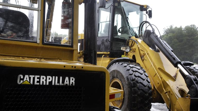 In this Monday, July 24, 2017 file photo, Caterpillar loaders are parked in Middleton, Massachusetts.  (AP Photo / Elise Amendola)