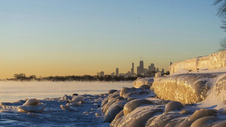 Chicago's lakefront is frozen over Friday, Jan. 25, 2019.  (Tyler LaRiviere / Chicago Sun-Times via AP)