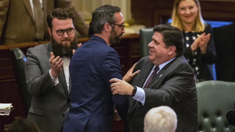 Gov. J.B. Pritzker, right, congratulates state Rep. Will Guzzardi, D-Chicago, left, on the House floor at the Illinois State Capitol on Thursday, Feb. 14, 2019. (Justin L. Fowler / The State Journal-Register via AP)