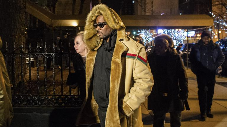 R. Kelly walks to his vehicle after exiting a cigar lounge in Chicago on Monday, Feb. 25, 2019.  A suburban Chicago woman posted the $100,000 bail for R. Kelly to be freed from jail while he awaits trial on sexual abuse charges.  (Tyler LaRiviere / Chicago Sun-Times via AP)
