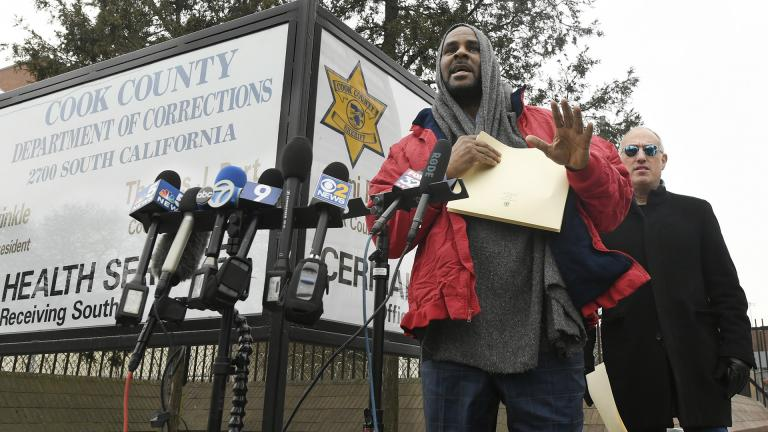 Singer R. Kelly left, speaks to the media while his attorney Steve Greenberg right, looks on after being released from Cook County Jail, March 9, 2019, in Chicago. (AP Photo / Paul Beaty)