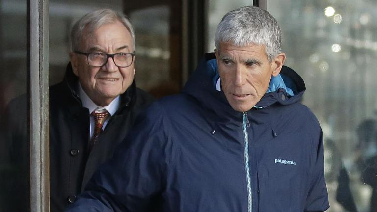 "William ""Rick"" Singer, front, founder of the Edge College & Career Network, exits federal court in Boston on Tuesday, March 12, 2019, after he pleaded guilty to charges in a nationwide college admissions bribery scandal. (AP Photo / Steven Senne)"