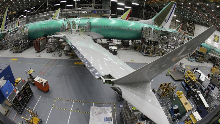 In this March 27, 2019, file photo taken with a fish-eye lens, a Boeing 737 MAX 8 airplane sits on the assembly line during a brief media tour in Boeing's 737 assembly facility in Renton, Washington. (AP Photo / Ted S. Warren, File)