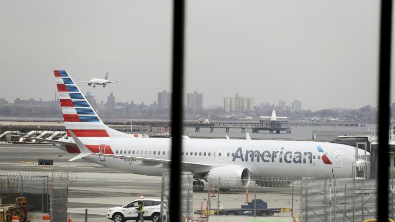 In a March 13, 2019 file photo, an American Airlines Boeing 737 MAX 8 sits at a boarding gate at LaGuardia Airport in New York. (AP Photo / Frank Franklin II, File)