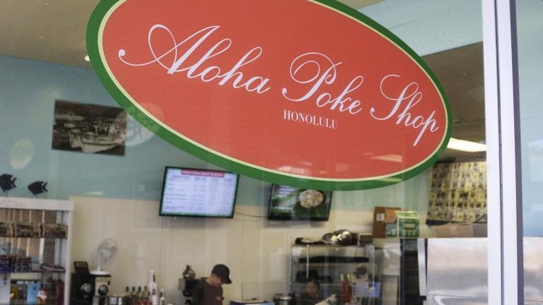 This Tuesday, April 16, 2019, photo shows Aloha Poke Shop, a store in Honolulu. (AP Photo / Audrey McAvoy)