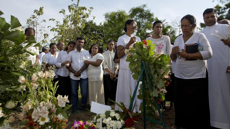 Family members mourn Tuesday, April 23, 2019 at the burial of 7-year-old Dhulodh Anthony, a victim of an Easter Sunday bomb blast, at Methodist cemetery in Negombo, Sri Lanka. (AP Photo / Gemunu Amarasinghe)
