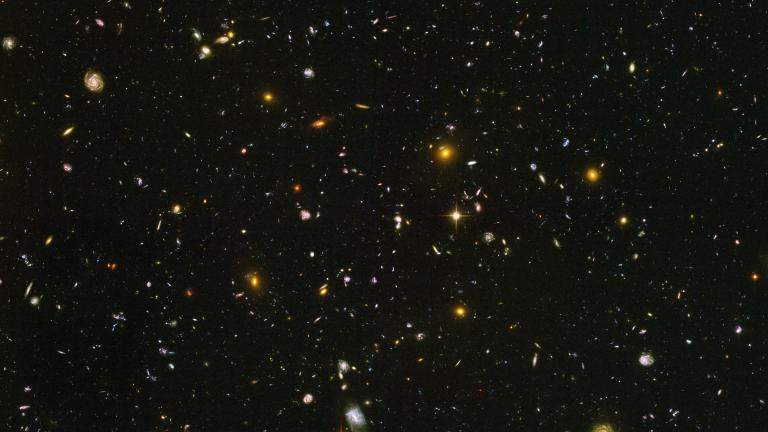 This image made from a composite of September 2003 - January 2004 photos captured by the NASA/ESA Hubble Space Telescope shows nearly 10,000 galaxies in the deepest visible-light image of the cosmos, cutting across billions of light-years. (NASA, ESA, S. Beckwith (STScI), HUDF Team via AP)