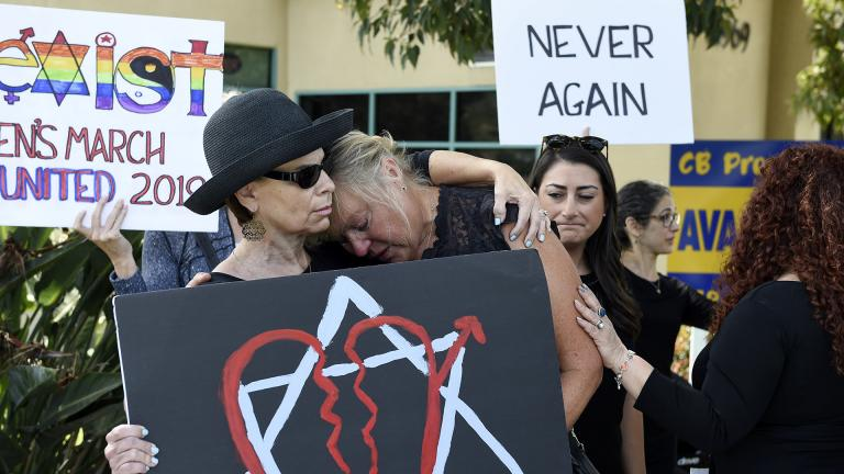 Leslie Gollub, left, and Gretchen Gordon hug at a vigil held to support the victims of the Chabad of Poway synagogue shooting, Sunday, April 28, 2019, in Poway, California. (AP Photo/Denis Poroy)