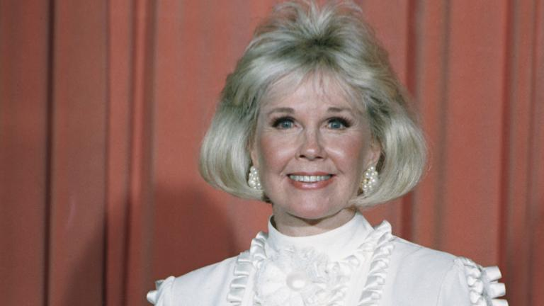 In this Jan. 28, 1989 file photo, actress and animal rights activist Doris Day poses for photos after receiving the Cecil B. DeMille Award she was presented with at the annual Golden Globe Awards ceremony in Los Angeles. (AP Photo, File)